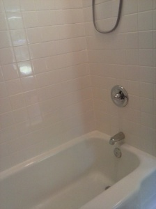 New wall, new drain/supply lines, 4X4 tile surround 1960's tub