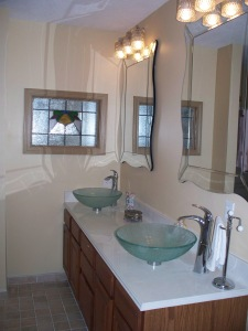 Stained glass, new countertop, lights, mirrors and vessel sinks and faucets